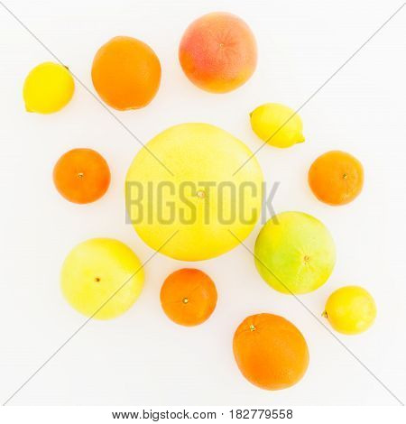 Fresh lemon, orange, mandarin, grapefruit, sweetie and big pomelo fruits on white background. Flat lay, top view.