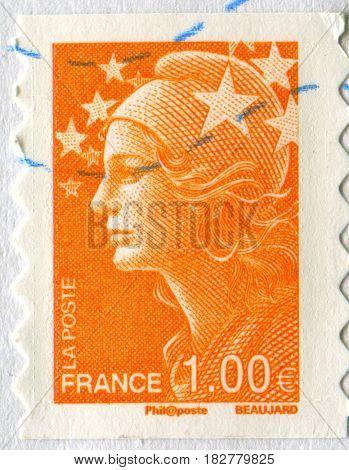 GOMEL, BELARUS, APRIL 20, 2017. Stamp printed in France shows image of  The Girl in orange, circa 2000.