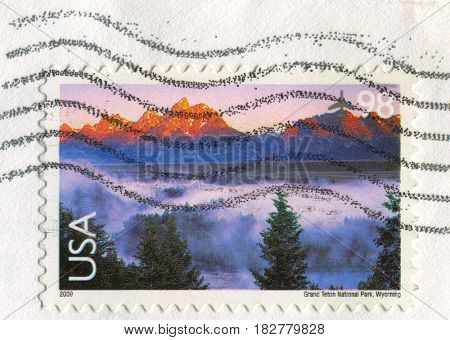 GOMEL, BELARUS, APRIL 21, 2017. Stamp printed in USA shows image of  The Grand Teton National Park, Wyoming, circa 2009.