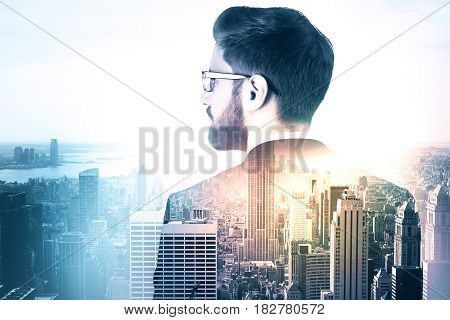 Side view of thoughtful young man on abstract city background with copy space. Future concept. Double exposure