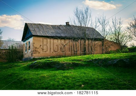rural landscape. rural house on a summer glade