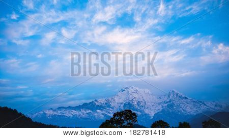Himalaya mountains with blue sky background. Nepal
