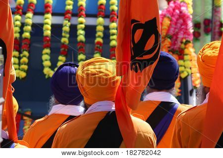 Men In Orange Dress During A Sikh Event