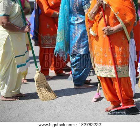 Barefoot Women Sweep The Way During The Sikh Religion Ceremony