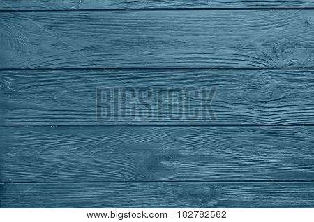 Blue painted wood board texture and background. Blue natural wooden background. Wood planks pattern. Wooden surface. Horizontal timber texture. Blue color wood barn. Wood board background. Blue wooden barn background.