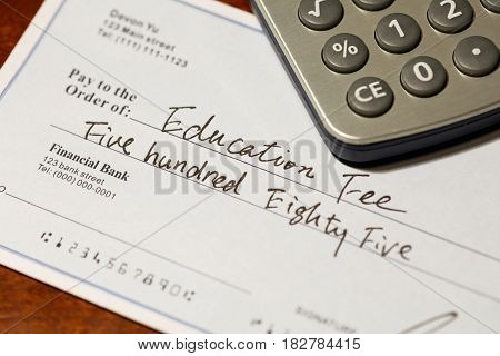 Fake cheque cheque for education fee financial concept.