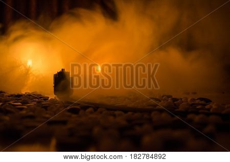 Ancient Steam Locomotive In Night. Night Train Moving On Railroad. Orange Fire Background. Horror My