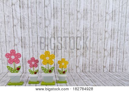 Decorative handmade wooden Flowers on structure background