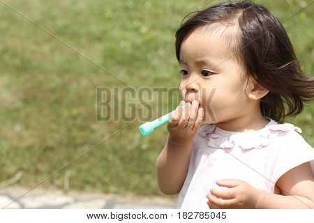 Japanese Girl Playing With Bubble (1 Year Old)