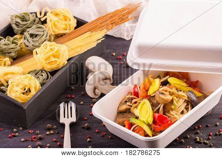 Spaghetti with eggplants and sweet pepper, champignon mushrooms and tomatoes