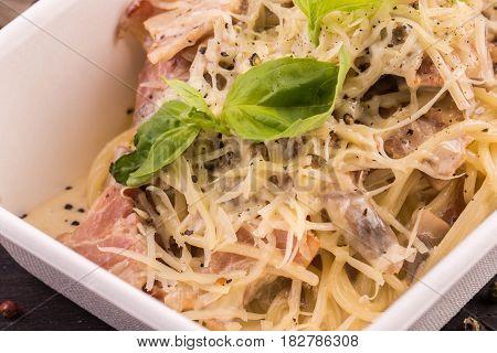 Spaghetti, sauce carbonara, champignon mushrooms and cheese parmesan