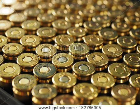 Shooting range. Ordered series of golden bullets.