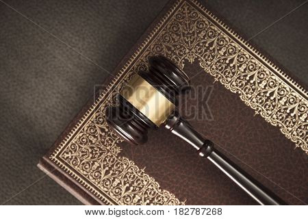 Legal system concept. Mallet of the judge and legal code as symbols of legal system.