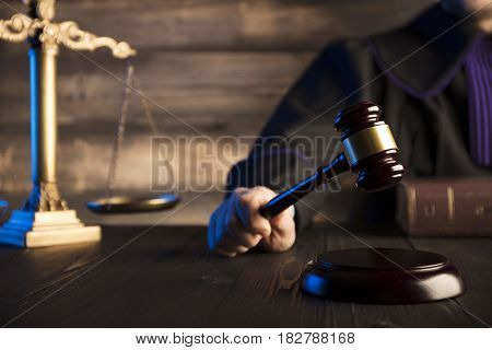 Mallet in the hand of the judge. Law concept.