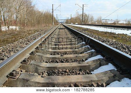 rails of railway forward go into distance