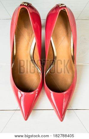 Stylish Pink Stiletto Shoes or High Heels on Wooden Background