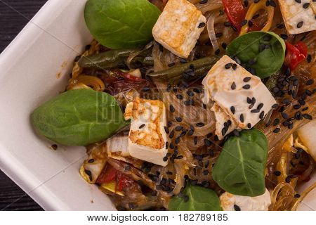 Noodles rice with tofu cheese and young spinach, ginger sauce and Kenyan haricot, sprouts of soy and sweet pepper
