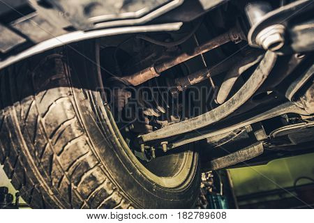 Car Steering and Suspension Maintenance in the Auto Service. Front Wheel Drive and Suspension Closeup Photo.