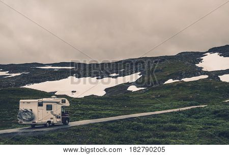 Camper Van and Rainy Weather During Spring Trip in Norway. Motorhome RV on the Mountain Road.