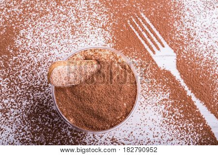 Tiramisu on the basis of mascarpone cheese with savayarda cookies in coffee impregnation