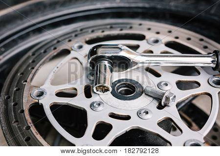 Metal Wrench On Motorcycle Disk Brake