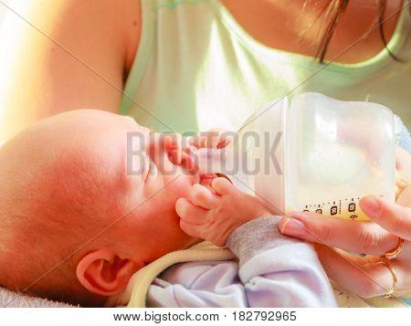 Little Newborn Eating Drinking From Bottle