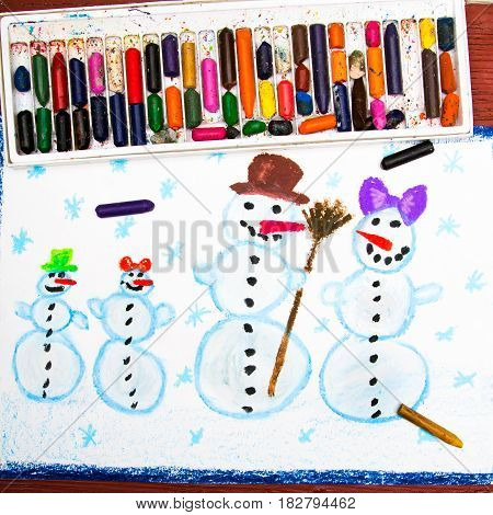 colorful drawing and crayons: Happy snowman familly