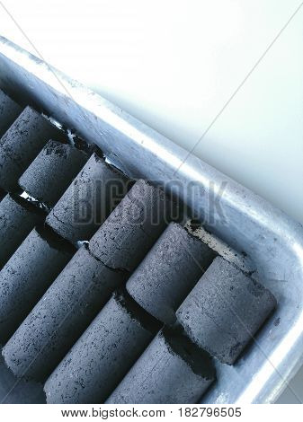 Close up of the coconut shell charcoal briquette.