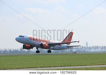 Amsterdam the Netherlands - April 2nd 2017: G-EZMH easyJet Airbus A319-100 takeoff from Polderbaan runway Amsterdam Airport Schiphol