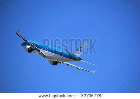 Amsterdam the Netherlands - April 2nd 2017: PH-EZH KLM Cityhopper Embraer ERJ-190STD takeoff from Polderbaan runway Amsterdam Airport Schiphol