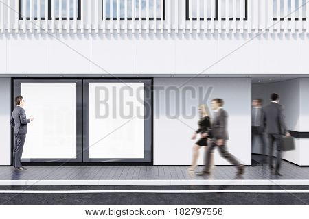 Business people passing by a shop window with two posters and a white balcony on the second floor. Concept of promotion. 3d rendering mock up