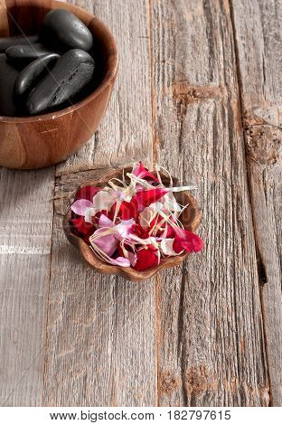 Spa Accessories: Hot Stones For Massage And Flowers