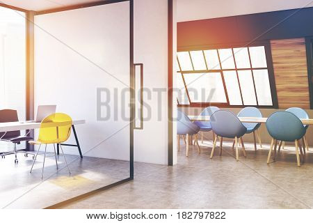 Corner of an attic conference room interior with a long wooden talbe surrounded by blue chairs and a CEO office on the left. 3d rendering toned image.