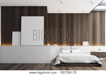 Front view of a bedroom with dark wooden walls a double bed and two blank posters to the left of it. 3d rendering mock up