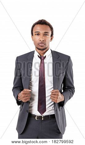 Isolated portrait of a serious African American businessman with a beard wearing a gray suit and a tie.