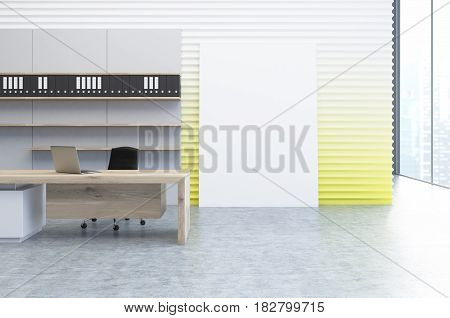 Interior of a clerk office with a yellow wall a veritcal poster standing beside it a wooden desk and a bookcase with folders. 3d rendering mock up