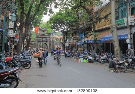 HANOI VIETNAM - NOVEMBER 24, 2016: Unidentified people visit Hanoi Old Quater district.