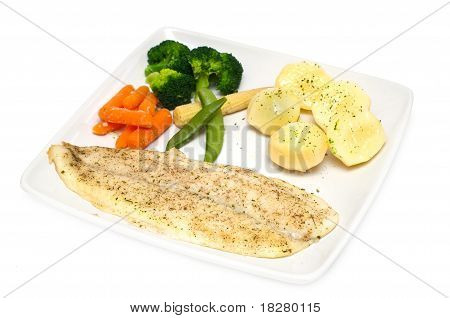 cod fillet with vegetables on white