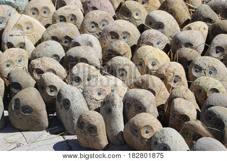 Stone owls carved sunny shadows ground shapes