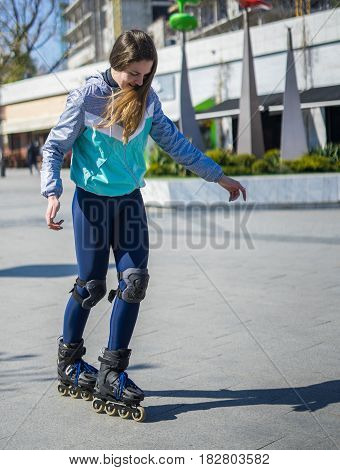 Beautiful Roller Girl is learning how to skate. First time on roller skates.