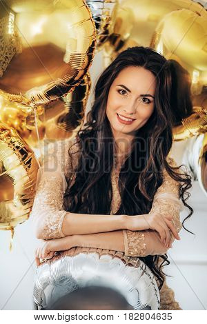Happy Glamour Woman on a gold party. Party people