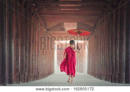 Buddhist novice is walking in temple Myanmar