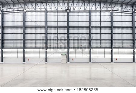 Wall siding of Huge empty store warehouse