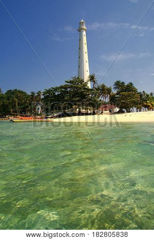 The iconic old lighthouse in Lengkuas Island, Belitung, Indonesia