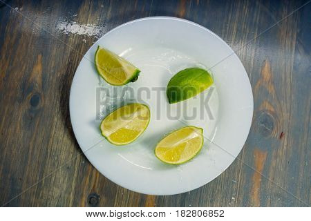 tropical fruits citrus lime fall deeply under water with a big splash on plate