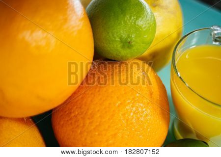 Fruit of citrus, orange, lime, lemon, pomelo, grapefruit with orange juice in a glass of glass