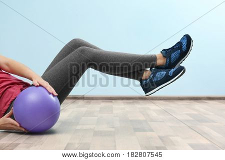 Girl training with ball in gym