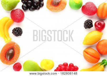 Frame made of fruit jelly candies on white background