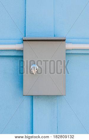 Plain Electric Control Enclosure on Blue Concrete Wall