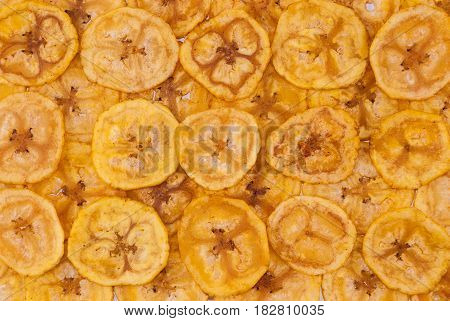 Closeup to Banana Chips Background / Texture